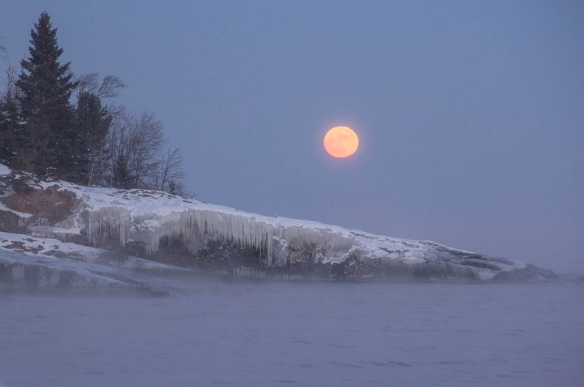 The Full Wolf Moon rising through the sea smoke on a VERY frigid January evening.  Put a Lake Superior moon rise on your bucket list!